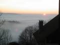Haut du tôt - vallée dans le brouillard